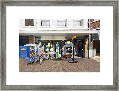 A Display Of Goods On The Street Framed Print by Corepics