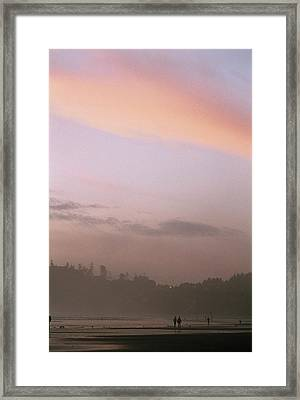 A Distant View Of People Walking Framed Print by Phil Schermeister