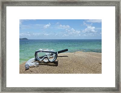 A Diving Mask And Snorkel On A Rock Near The Sea Framed Print by Caspar Benson