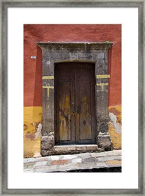 A Door In A Painted Building Framed Print by David Evans