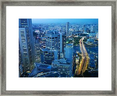 A Dramatic Night Scene Of The Central Framed Print by Justin Guariglia