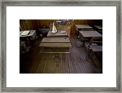 A Dunce Cap Sits On A Desk In An Framed Print by Hannele Lahti