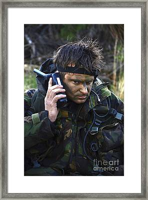 A Dutch Patrol Commander Communicates Framed Print by Andrew Chittock