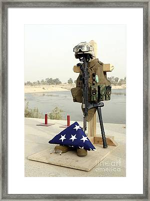 A Fallen Soldiers Gear Display Framed Print by Stocktrek Images
