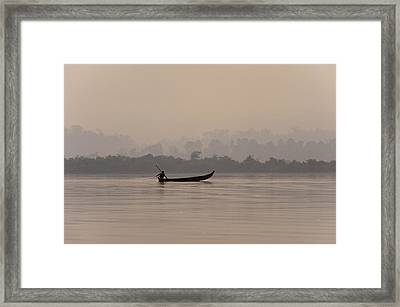A Fisherman Pulls In His Net Framed Print by Alex Treadway