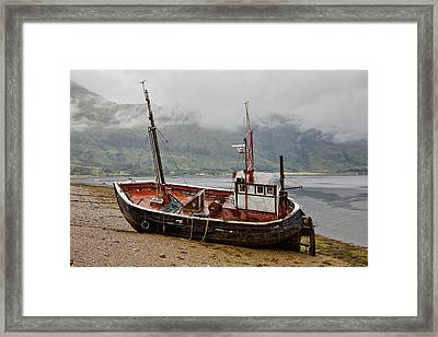 A Fishing Boat Abandoned On The Shore Framed Print by John Short