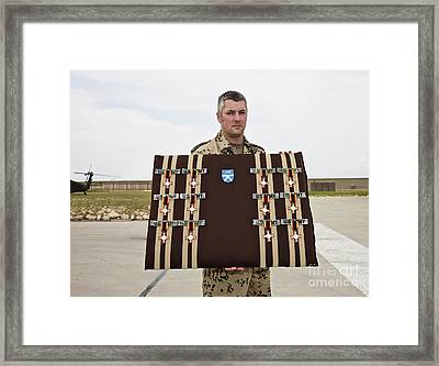 A German Soldier Holds A Display Framed Print by Terry Moore