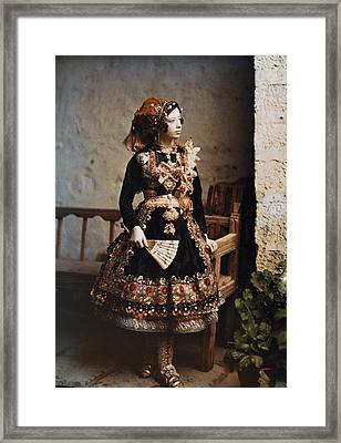 A Girl Poses In Her Traditional Costume Framed Print by Gervais Courtellemont
