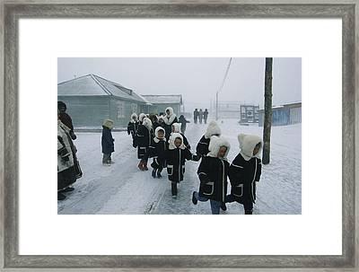 A Group Of School Children Run Framed Print by Maria Stenzel