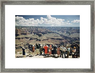 A Group Of Visitors At Hopi Point Framed Print by Justin Locke