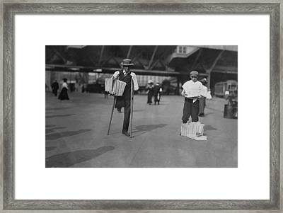A Handicapped Man Selling Newspapers Framed Print by Everett