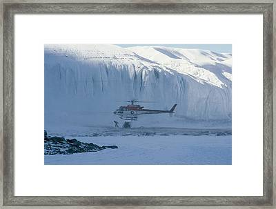 A Helicopter Delivers Supplies Framed Print by Maria Stenzel