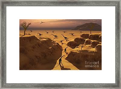 A Herd Of Omeisaurus Dinosaurs Migrate Framed Print by Mark Stevenson