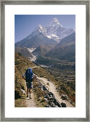 A Hiker With A Mountain Range Framed Print by Michael Klesius