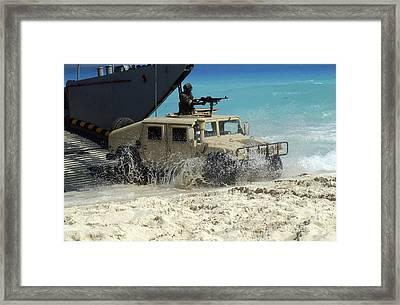 A Jordanian Hmmwv Unloads From An Framed Print by Stocktrek Images