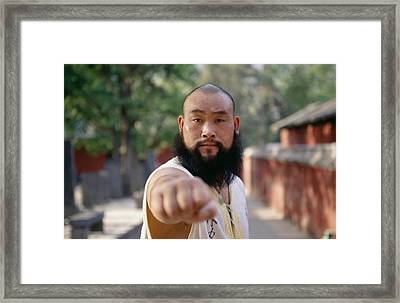 A Kung Fu Monk Throws A Punch Framed Print by Justin Guariglia