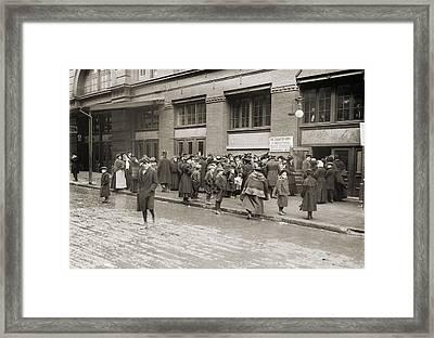 A Line Of Women Waiting Framed Print by Everett