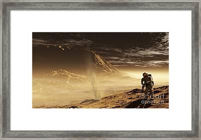 A Lone Astronaut Drills Framed Print by Steven Hobbs