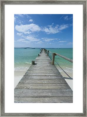 A Long Wooden Jetty At Churchhaven In The West Coast National Park Disappears Into The Turquoise Waters Of The Langebaan Lagoon, Churchhaven, Western Cape, South Africa Framed Print by Neil Austen