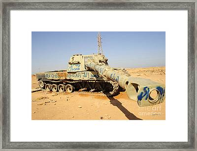 A M109 Howitzer Destroyed By Nato Framed Print by Andrew Chittock