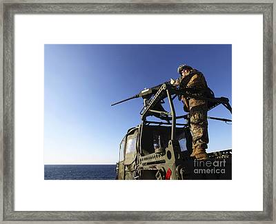 A Machine Gunner Mounts A M-2 Framed Print by Stocktrek Images