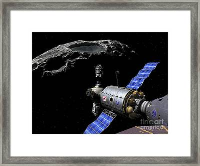 A Manned Maneuvering Vehicle Undocks Framed Print by Walter Myers