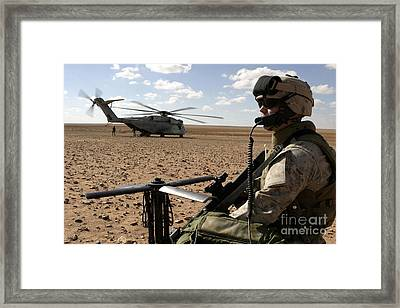 A Marine Assembles A Radio Antenna Framed Print by Stocktrek Images