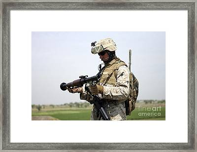 A Marine Looks At A Brand New Framed Print by Stocktrek Images