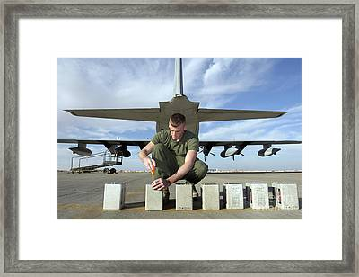 A Marine Replaces Flares In Flare Framed Print by Stocktrek Images