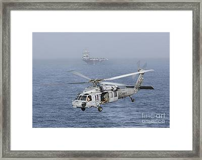 A Mh-60s Knighthawk Conducts A Vertical Framed Print by Gert Kromhout