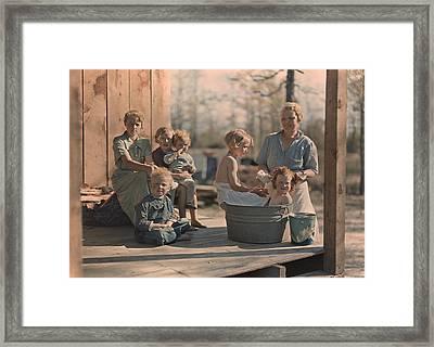 A Mother Bathes Her Children Framed Print by J. Baylor Roberts