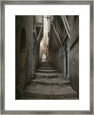 A Muslim Woman Walking Down A Steep Framed Print by Gervais Courtellemont