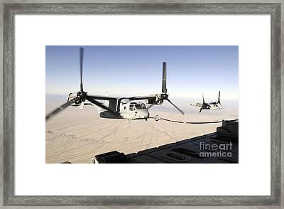 A Mv-22 Osprey Refuels Midflight While Framed Print by Stocktrek Images