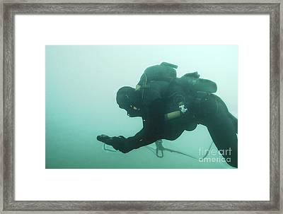 A Navy Seal Combat Swimmer Navigates Framed Print by Michael Wood