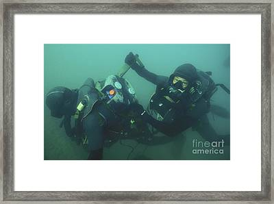 A Navy Seal Combat Swimmer Removes Framed Print by Michael Wood