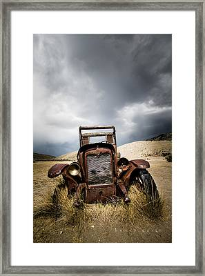 A Old Time Car Framed Print by Henny Gorin