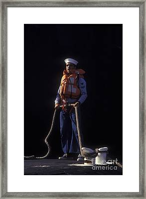 A Petty Officer Secures Rope Tied Framed Print by Michael Wood