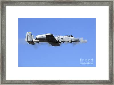 A Pilot In An A-10 Thunderbolt II Fires Framed Print by Stocktrek Images