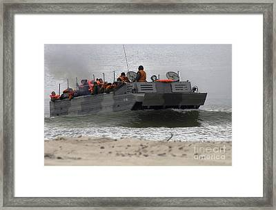 A Polish Amphibious Vehicle Drives Onto Framed Print by Stocktrek Images