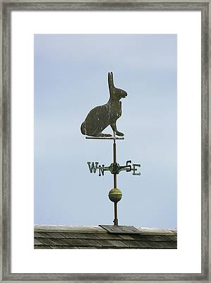 A Rabbit-shaped Weathervane Atop A Roof Framed Print by Darlyne A. Murawski