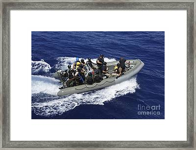 A Rigid-hull Inflatable Boat Carrying Framed Print by Stocktrek Images