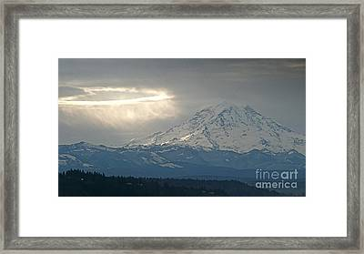 A Ring Of Bright Light Beside Mount Rainier Framed Print by Sean Griffin