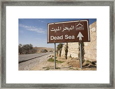 A Road Sign In Both Arabic And English Framed Print by Taylor S. Kennedy