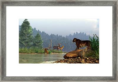 A Saber-tooth Hunting Deer Framed Print by Daniel Eskridge