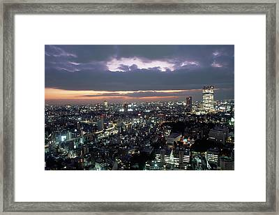 A Scene Of The Tokyo Skyline Framed Print by Justin Guariglia