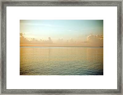 A Serene Landscape Of The Ocean And Sky At Sunrise Framed Print by Adam Hester