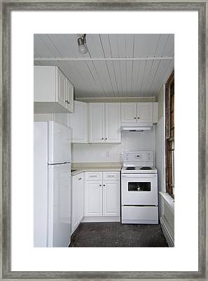 A Small Galley Kitchen In An Old Framed Print by Will Burwell