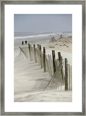 A Snow Fence Stretches Across A Dune Framed Print by Skip Brown