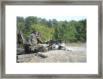 A Soldier Charges A .50-caliber Machine Framed Print by Stocktrek Images