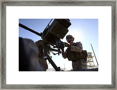 A Soldier Fires 40mm Rounds Framed Print by Stocktrek Images